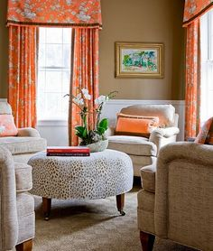 Orange curtains with camel wall colour