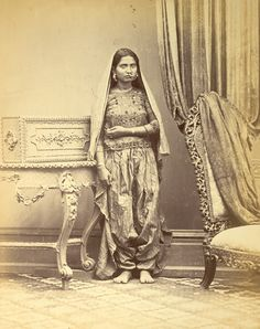 Portrait of a Muslim girl from Sindh, showing method of wearing ear and nose rings, and anklets - 1870s - Old Indian Photos