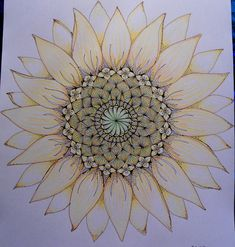Love the idea of its center being a mandala and then having normal petals {sunflower}