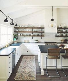 White never fails to give a kitchen design a timeless look. These stylish kitchens, including everything from white kitchen cabinets to sleek white tiles, are sure to serve as inspiration for your own kitchen design. Kitchen Cabinets Decor, Kitchen Cabinet Design, Home Decor Kitchen, Kitchen Ideas, Bar Cabinets, Kitchen Wood, Kitchen Layout, Kitchen Sink, Farmhouse Style Kitchen