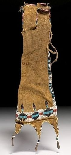 native american, America, Cheyenne diminutive beaded hide tobacco bag, last quarter 19th century, sinew-sewn on smoke-tanned hide using small (13/0) red white-heart, white, dark and light blue, and pony trader blue glass beads; pink, yellow, white, and pony trader real beads edge tabs at opening and bottom edge; augmented with tin cones.