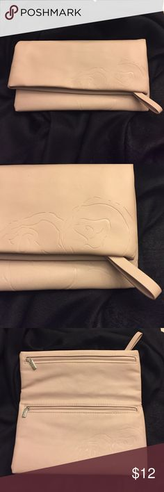 """Blush colored clutch Blush colored clutch with rose detail on the outside. Folds open with 2 zipper pockets on the inside folded part and one zipper at the top. Folded over it's 5 1/4"""" tall and 9"""" wide. Opened up it's about 9 1/4"""" tall. Was given as a gift and I've never used it so its in perfect condition. Bags Clutches & Wristlets"""