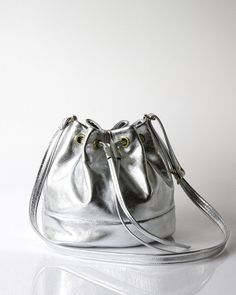 A silver leather bucket bag that's completely worth the splurge. #etsyfinds #etsygifts
