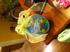 Easter egg made with yarn, sugar water, decorated and filled with candy and eggs