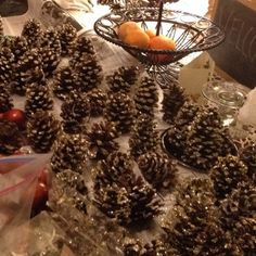 Sparkle pine cones! Spray glue and glitter! Perfect for winter decorations or wedding :)