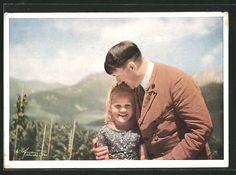 old postcard: AK Führer Adolf Hitler mit einem Mädchen im Arm