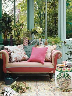 Secret garden. This spring trend feels lovely, light and bright. Make a working space that you can also relax in with a bench, big cushions and pretty, floral gardening tools
