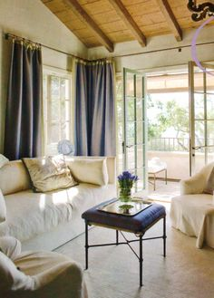 Interior Design Inspiratin. Lovely Living Room. Urban Cottage Chic. Love the french doors, sofa & pillows & chairs.  French blue and white; John Saladino
