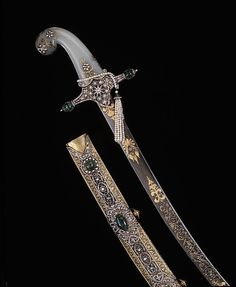 Sabre & Sheath. 19th Century, Turkey, Ottoman Empire. Iranian blade and steel, gold, diamonds, emeralds and pearls. The entire handle was skilfully crafted from a piece of solid jade. This is a ceremonial sword, used for an investiture ceremony. This sword is a perfect symbol of the luxury, extravagance and workmanship in the Ottoman Empire