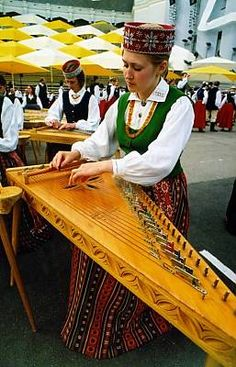 Playing the national instrument, the kokle.  ©  Latvian Folk Art Centre Archives