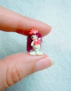 Tiny mermaid doll.