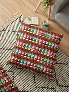 """Check out the variety of #ChristmasPillows like this one ~ """"Christmas Nutcracker Soldiers Floor Pillows"""" -  Colorful nutcracker solders with a red plaid like background. • Also buy this artwork on home decor, apparel, stickers, and more. #Gravityx9 #redbubble #nutcrackerdecor #nutcrackerpillow #christmasnutcracker #homedecor #holidaydecor"""