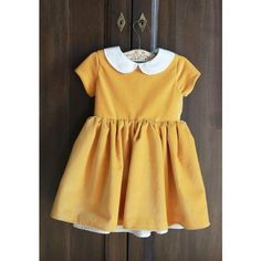 The Patsy Dress ❤ liked on Polyvore featuring dresses, petticoat dresses, button back dress, brown dress, peter pan dress and peter pan collar dress