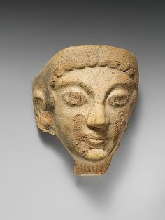 Terracotta antefix (roof tile) with female head Date: 5th century B.C. Culture: Etruscan, Cerveteri