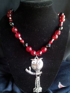Owl pendant with black and red spacer beads.