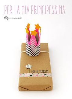 Ooh, how cute to have a little crown on an elastic instead of a bow on a gift? Very creative gift wrapping idea.