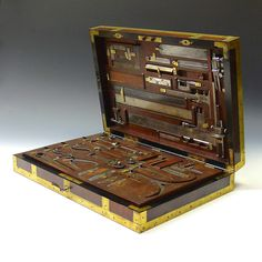View this item and discover similar metalwork for sale at - An exceptional brass bound mahogany box containing a comprehensive selection of measuring instruments. Adapted with heavy gauge brass brackets so the box