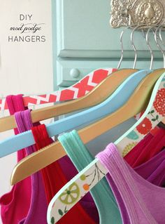 DIY Mod Podge Hangers! Transform wooden hangers with wrapping paper and mod podge