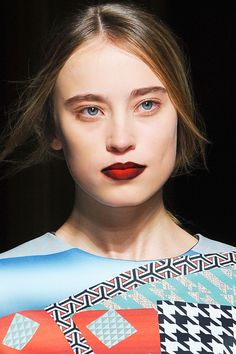 dramatic red lips are also back with a vengeance on this season's runway but with a new twist! Multi hued dramatic lips.