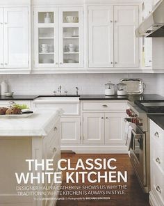 Classic white kitchen and i LOVE it. Love the white cabinets, black counter, white subway tile. Also like that it has wood floor and one glass cabinet.