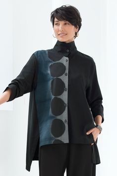 Circle Shoji Blouse by Steve Sells Studio . Known for his extraordinary artistry with fabric and dye, the designer starts with a finely checked fabric from Japan, then uses shibori dyeing techniques to create a bold pattern with subtle gradations of color.
