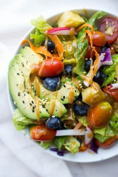 This Big Vegan Rainbow Bowl features fruits, vegetables, and an addictive maple almond butter dressing! The perfect summer meal!