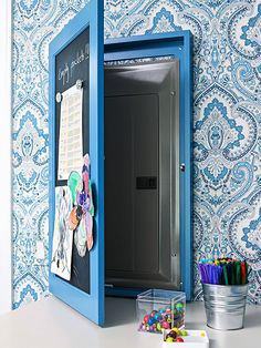 •Conceal a Circuit Breaker Box Guests will never guess that this magnetic chalkboard actually hides your home's circuit breaker box. Use the hinged message center to hang to-do lists, children's artwork, or coupons for laundry supplies.