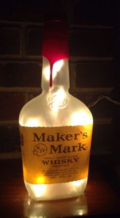 great Maker's Mark Frosted Lighted bottle lamp with frosted light set inside to illuminate the bottle. measures 10″ high and 3 1/2″ wide visit lightitupcreations.com Purchase this on Etsy!
