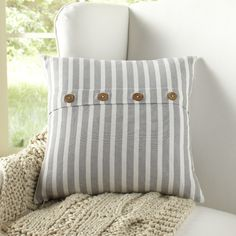 Sybil Pillow Cover | Wooden button closures accent this striped pillow cover, giving it a more casual, rustic feel.