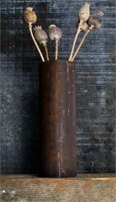 rusted pipe vase and poppy pods