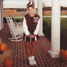 Pin for Later: The Hands-Down Greatest Supermodel Halloween Costumes From Years Past Ashley Graham Flashback to when she tied a bow in her hair and wore her mom's cheerleader varsity jacket.