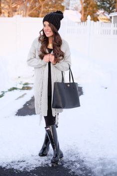 Long Gray Fringe Cardigan.  Black leggings. Tall original gloss hunter boots.  Tory burch perry tote.  Beanie hat.