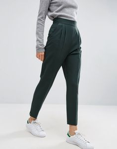 these chic forest green tapered work pants are a perfect addition to a holiday wardrobe