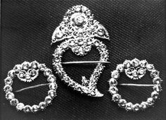 Set of 'keronsang', a type of brooch used for fastening the Nonya kebaya, a traditional costume worn by Peranakan women. These pieces of jewellery was featured in documentary on the community, produced by Singapore Broadcasting Corporation (SBC).  1978