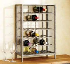 With an on-trend industrial-chic design, the Loft Metal Wine Rack at Cost Plus World Market stylishly organizes your wine collection. Flat sides let you arrange multiple racks next to each other to create as much wine storage as you need.