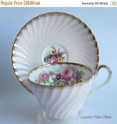 FREE SHIPPING TO CANADA AND USA ON ALL ORDERS OVER $69 USE COUPON CODE FSC6917 AT CHECKOUT Foley China 3189L Light Pink with Floral Center and Inside Swirled Bone China Tea Cup and Saucer Made in England by E.Brain No chips,cracks,crazing or Repairs. Any lightening in the photo is