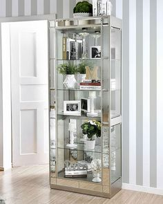 Let this chic Carrollton Curio Cabinet by Furniture of America make a dramatic statement in your contemporary home with its brilliant silver finish! The mirrored accents decorating the frame cast a reflection on your decorating taste while also accenting Shelf Furniture, Mirrored Furniture, Types Of Furniture, Furniture Sale, Furniture Websites, Online Furniture, Glass Shelves In Bathroom, Floating Glass Shelves, Tempered Glass Shelves