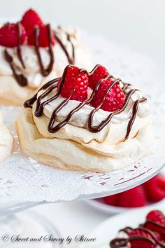Triple Raspberry Mini Pavlova - Infused with raspberry flavor in each layer and drizzled with chocolate ganache, these delicate mini pavlova dessert's are an effortless crowd-pleaser! Mini Desserts, Sweet Desserts, Easy Desserts, Delicious Desserts, Dessert Recipes, Raspberry Desserts, Baking Recipes, Healthy Recipes, Decadent Chocolate Cake
