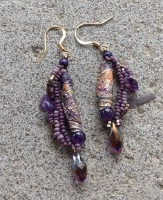 These are such sweet Beaded learrings in purple and gold.  See them in my shop: JudesArt on Etsy