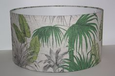 I am in love with this! NEW Palm Trees lampshade!!!! 100% Linen. A high quality Handmade lampshade with a rolled edge and rigid flame retardant PVC. Samples available on request. As a guide, I suggest 40cm and smaller are suited to table lamps, and 40cm upwards are more suited to ceiling and floor lamps. Made with a European ring fitting. I also include a 29mm adaptor for UK fittings. Can be used for ceiling, floor or table lamps. Recommend bulb wattage: Maximum 40 watt or energy saving...