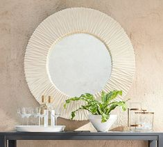 The rippled texture of the Tulum Mirror makes it an eye-catching focal point in an entry or an outdoor patio. With its hand-painted ivory finish, it has a sun-drenched look that's perfect as a summer accent. Round Wall Mirror, Dresser With Mirror, Round Mirrors, Outdoor Mirror, Outdoor Walls, Wooden Console Table, Wicker Dining Chairs, Red Brick Walls, White Texture