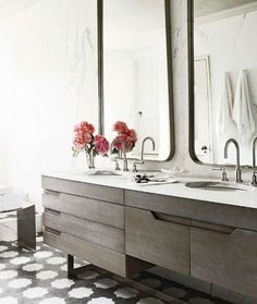 pattern floor + mirrors + cabinets in chic bathroom design