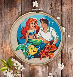 This is modern cross-stitch pattern of the Little Mermaid for instant download. Nice cross-stitch version of Disney cartoon. This picture could decorate a kids room in joyful colors. You will get 7-pages PDF file, which includes: - main picture for your reference; - colorful scheme for cross-stitch; - list of DMC thread colors (instruction and key section); - list of calculated thread length The size of the picture is 6.93 X 7.50 (17.60 cm X 19.05 cm) - 120 X 120 stitches on Aida 14 count…