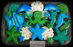Fish, octopus, sea stars (star fish), sea horse, sand dollar, shells, and dolphin cookies by Sugar Cravings