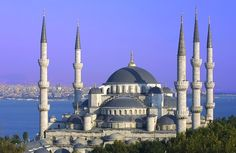 The Blue Mosque, Istanbul, Turkey;  an active mosque;  blue tiles surrounding the interior of the mosque;  women must wear a head covering when they enter the mosque;  Muslims pray 5 times a day;  the mosque is closed during these times
