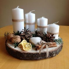 Cheap and Easy Christmas Centerpiece Ideas that you can Make in a Jiff - Hike n Dip Thinking about easy and cheap christmas centerpiece ideas that you can do by yourself? Look here for some of the easiest Christmas centerpiece ideas. Christmas Advent Wreath, Christmas Candle Decorations, Cheap Christmas, Noel Christmas, Christmas Candles, Modern Christmas, Rustic Christmas, Simple Christmas, Christmas Crafts