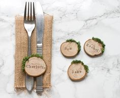 Rustic wood slice and moss wedding place settings / escort cards, perfect for an outdoor woodland or barn wedding. A lovely personalised wooden