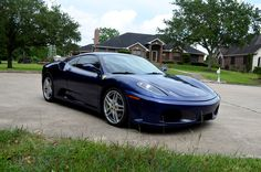 This 2006 Ferrari F430 Berlinetta shows just 18,725 miles and is finished in Tour de France Blue over Beige. A service performed at 17,440 miles included new brakes, tires, and a clutch. The 4.3-liter DOHC V8 was serviced on May 6, 2017 and is paired to a 6-speed F1 automated manual transmission.
