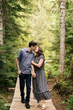 couple laughs hiking engagement Photos