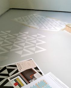 How to paint a concrete floor with stencils - Craft room floor makeover - Collected and vintage boho - Geometric floor pattern